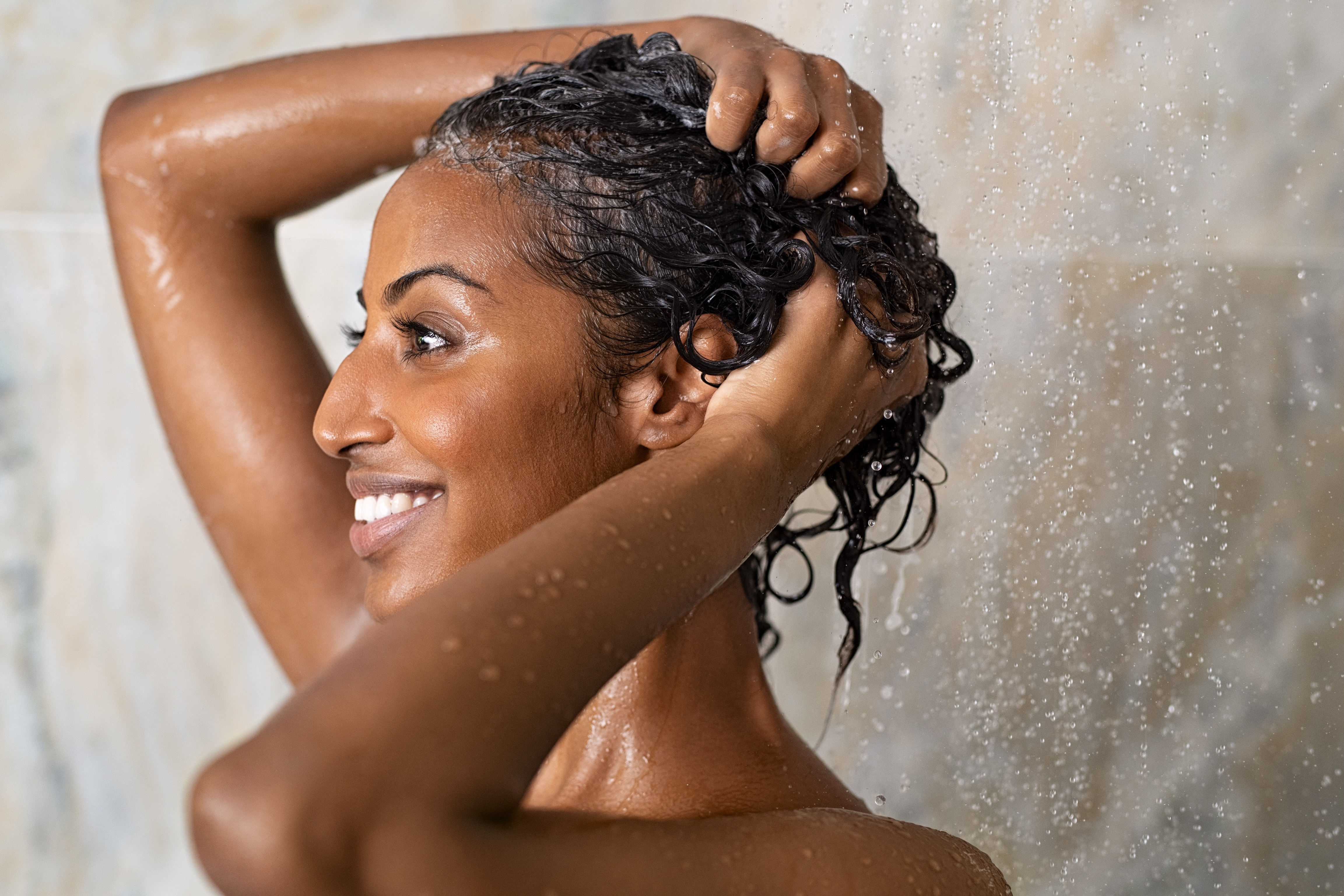 How To Wash Curly Hair Properly